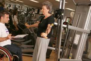 Disabled instructor in gym